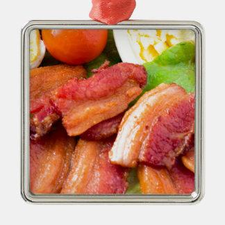 Ornamento De Metal Fragmente o close up do prato com alface shredded,