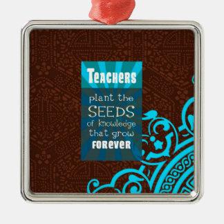 Ornamento De Metal Os professores plantam as sementes que crescem o