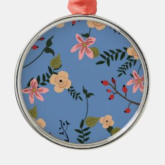 Ornamento De Metal Padrões florais retros em um fundo azul