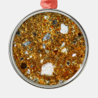 Ornamento De Metal Seção fina de um tijolo sob o microscópio