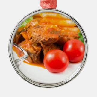 Ornamento De Metal Veja o fim-acima em uma refeição do guisado de