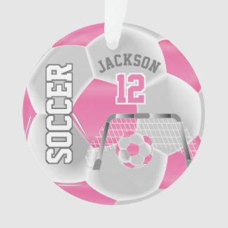 Ornamento O rosa e o branco personalizam a bola de futebol