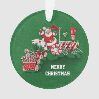 Ornamento Papai noel do Natal que monta o trem dos doces de