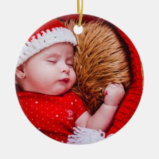 Ornamento redondo do primeiro Natal do bebê