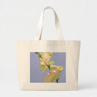 Orquídeas amarelas e cor-de-rosa na lavanda bolsas de lona
