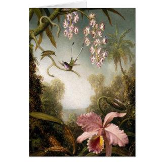 Orquídeas do pulverizador com o cartão de nota do