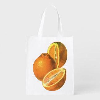 Os alimentos do vintage, frutificam laranjas sacola ecológica para supermercado