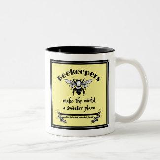 Os apicultor fazem ao mundo uma caneca mais doce