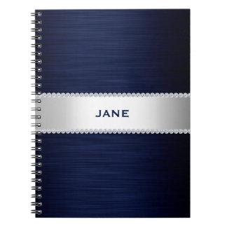 os azuis marinhos metal com diamantes e nomeiam caderno