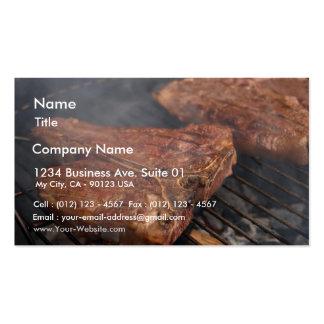 Os bifes que grelham o assado grelham a carne cartoes de visita