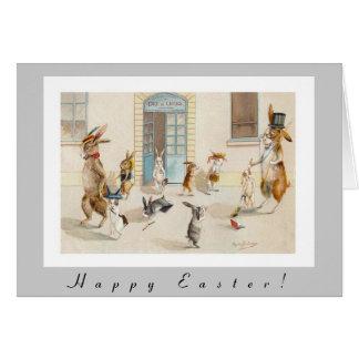 Os coelhos antropomórficos dirigem em casa da cartão