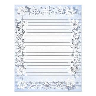 Os flocos de neve limitam o papel de carta