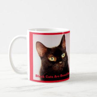 Os gatos pretos são caneca de café bonita (versão