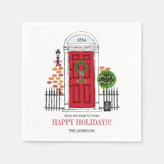 Os guardanapo de papel da porta vermelha do Natal