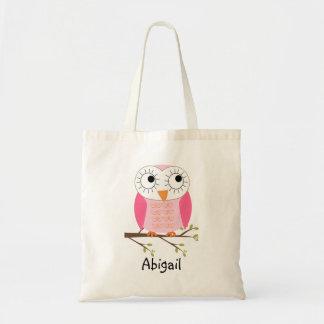 Os miúdos personalizaram a sacola cor-de-rosa da bolsa para compras