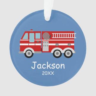 Os miúdos vermelhos do carro de bombeiros ornamento