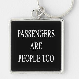 Os passageiros são do viagem do slogan pessoas do  chaveiro quadrado na cor prata
