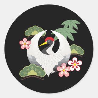 Os símbolos afortunados japoneses refrigeram o adesivo redondo