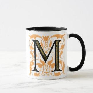 """Ouro & caneca floral de """"M"""" do preto -"""