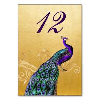 Ouro com o cartão do número da mesa do casamento