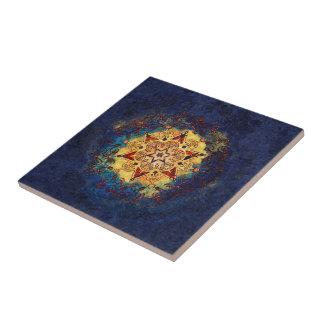 Ouro do brilho da estrela e azulejo cerâmico azul