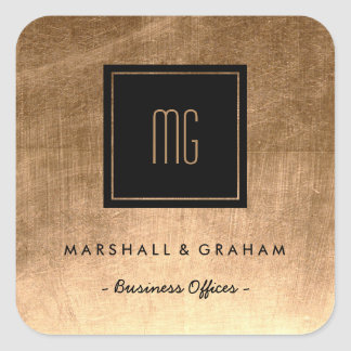 Ouro e etiquetas pretas do negócio do monograma