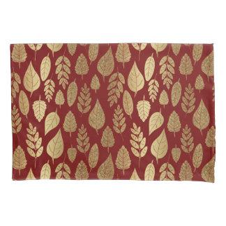 Ouro e teste padrão vermelho da folha