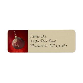 Ouro na etiqueta vermelha de Avery do ornamento