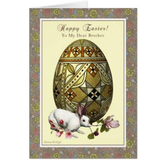 Ovo da páscoa e coelho do irmão cartão comemorativo