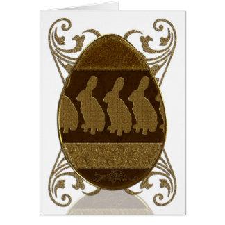 Ovo da páscoa, ovo da páscoa dourado com coelhos cartão comemorativo