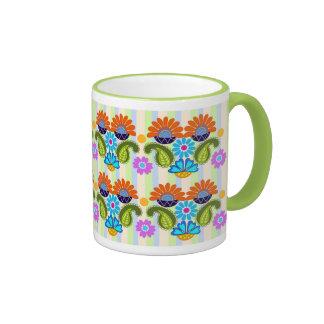 Paisley colorido bonito e caneca floral dos padrõe