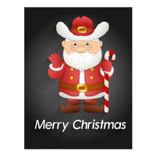 Papai Noel bonito com o cartão do bastão de doces