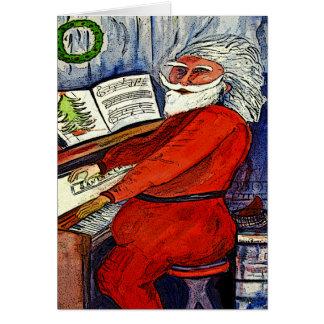 Papai noel do piano que cumprimentam e cartões de