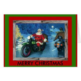 Papai noel em um cartão de Natal da motocicleta