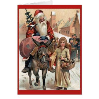 Papai noel no cartão do natal vintage do asno
