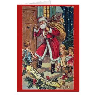 Papai noel que bate o cartão do natal vintage