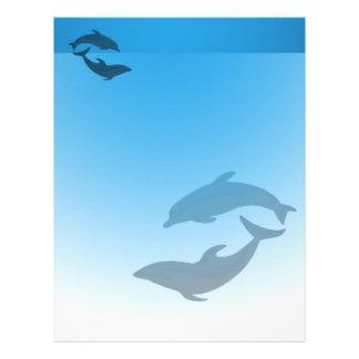 Papel de carta do cabeçalho dos golfinhos do azul