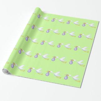 Papel de embrulho verde da cegonha para o bebê