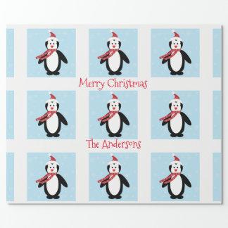Papel De Presente Pinguim bonito em um Natal do chapéu do papai noel