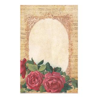 Papelaria Afligido com beira dos rosas e de notas musicais