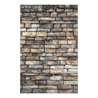 Papelaria O cinza telha a parede de tijolo