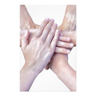 Papelaria Seis braços unem-se com as mãos em se