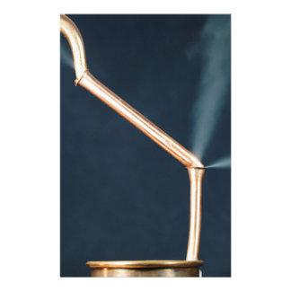 Papelaria Tubulações de cobre com um escape e um vapor