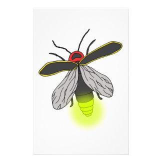 Papelaria vôo do inseto de relâmpago iluminado