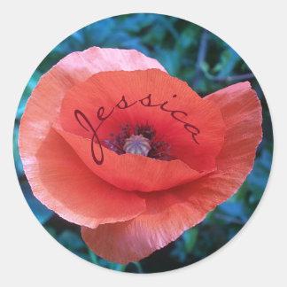 Papoila vermelha. monograma adesivo redondo