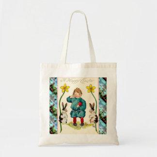 Páscoa do vintage, menino com coelhos bolsas para compras