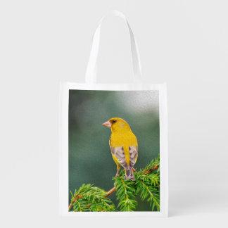 Pássaro amarelo no ramo sacolas reusáveis