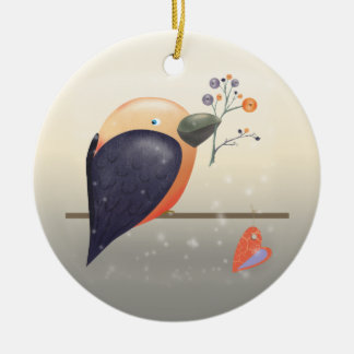 Pássaro do pisco de peito vermelho e enfeites de