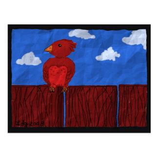 Pássaro vermelho em um cartão da cerca