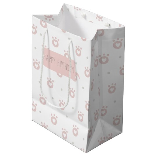 Patas bonitos do animal de estimação com o saco do sacola para presentes média